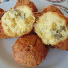 Jillena's Crab Hush Puppies - These quick and easy hush puppies have an added twist of crabmeat to the batter. Serve alongside hot cheese dip or tartar sauce for a tasty appetizer.