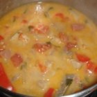 Brazilian Fish Stew - Tilapia is marinated in lime juice and spices before being made into a coconut milk-based stew with onions, bell peppers, and tomatoes in this Brazilian recipe.