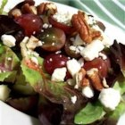Waldorf Goat Cheese Salad - Red leaf lettuce tossed with raspberry walnut vinaigrette and topped with grapes, pecans, and goat cheese.