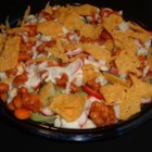 Western Salad - All your favorite raw vegetables are topped with zesty beans, cool ranch dressing, and crunchy, cheesy chips.