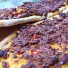 Armenian Pizzas (Lahmahjoon) - These individual-sized pizzas are made with tortillas or pitas topped with ground lamb in a tomato-based sauce seasoned with cumin, turmeric and other spices. They're even great as leftovers the next day with a dollop of yogurt on top.
