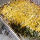 Cheesy Creamed Spinach Casserole - Spinach casserole cooked with onion soup mix and sour cream, topped with Cheddar cheese.