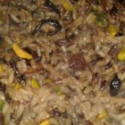 Orange Wild Rice with Pistachios and Cranberries - Dried cranberries and pistachios are added to wild rice that has a mild orange flavor to create this hearty and easy dish.