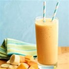 Supercharged Smoothie - Papaya, fresh turmeric, fresh ginger, and almond milk are blended together in this supercharged smoothie.