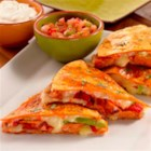 Smoked Andouille Quesadilla - Quesadilla wedges with slices of browned andouille sausage, provolone cheese, roasted peppers, veggies, and more make delicious appetizers or hors d'oeuvre for any festive event.