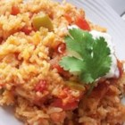 Spanish Rice II - Rice is sauteed with onion and green bell pepper, and then simmered with water, chopped tomatoes and spices.