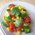Mexican Cucumber Salad - Cool summer vegetables and warm spices make for a colorful, zesty salad!