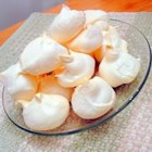 Merenges - This is a Puerto Rican recipe. The meringues are as light as a cloud and not messy, you can make a lot of them, and they have a hint of lemon.