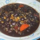 Beezie's Black Bean Soup - This slow cooker black bean soup features tomatoes, jalapenos, garlic, rice, lentils, chili powder and more!
