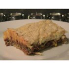 Cheeseburger Pie - Ground beef, vegetables, and tomatoes are layered with cheese and baked in a crust made with buttermilk baking mix. Serves 12.