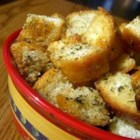 Yummy Garlic Croutons - You may forget the salad and just eat these fabulous croutons. Olive oil and  garlic powder are sprinkled on before toasting, but the real secret is the dried basil.