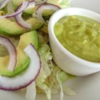 Avocado Salad with Avocado-Lime Vinaigrette - Avocados, red onion, and lettuce are tossed together with a simple avocado-lime vinaigrette to make this delicious and tangy salad.