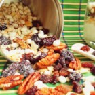 Homemade Muesli - Make a healthy homemade breakfast cereal with oats, pecans, almonds, dried cherries, and raisins using this recipe.