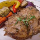 Roasted Rosemary Chicken And Vegetables - Chicken, bell peppers, eggplant, carrots and onion cook in balsamic vinegar spiked with rosemary.  This aromatic dish can be served hot or at room temperature.