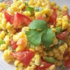Cilantro Tomato Corn Salad - Very quick and tasty sidedish that can be altered to taste, almost every ingredient except the corn is optional. Very pretty side dish also.  I've made this for many different people and haven't had one complaint yet. It's especially good if you just don't have the time to cook but don't want junk food.