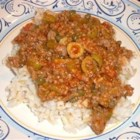 Picadillo - Ground beef, onions, green bell peppers, garlic and tomatoes, stewed together and seasoned with cloves, cinnamon and bay leaves. Can be served alone or with rice.