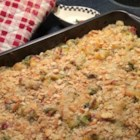 Ham and Potato Casserole - This creamy potato and ham casserole is packed with a variety of vegetables and will please the whole family.