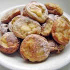 Aebleskiver - Aebleskiver - a Danish dessert, like doughnut holes, but sweeter and much better traditionally served with glogg during the Advent. Cooked in a cast iron pan that resembles an egg poacher. Serve hot with syrup, jam or powdered sugar.