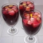 Sangria ala Felicia - This fruity wine and rum cocktail is sweetened with simple syrup and orange juice.