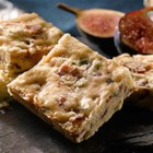 Maple Glazed Bacon and Chive Shortbread - Savoury-salty-sweet bacon shortbread squares with hints of chive and maple are delicious served alone as an appetizer or added to a cheese plate.