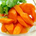 Buttery Cooked Carrots - Baby carrots are gently boiled and then simmered with brown sugar and margarine.