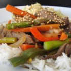 Essanaye's Sesame Beef Stir Fry - This sweet and savory beef stir-fry has plenty of colorful vegetables, including asparagus, mushrooms, and red bell peppers. All you need is a steaming bowl of rice to complete this meal.