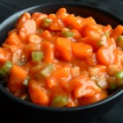 Marinated Carrot Salad - Tender coins of cooked carrots are tossed with crisp celery, green onions and bell pepper and marinated in a sweet and tangy tomato-based marinade.