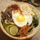 Dol Sot Bi Bim Bap - Dol Sot Bi Bim Bap is Korean for Hot Stone Bowl with Mixed Rice - oh, and vegetables, and meat, and egg. My 'go to' favorite Korean dish, next to haemul pajeon and Bulgogi. I'm a big carnivore so my version has about 25% more meat than the traditional version. Mmmmmm, cow!