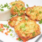 Irish Zucchini and Potato Pancakes - A favorite dish to eat during Lent, these Irish zucchini and potato pancakes are delicious with sour cream, applesauce, or even ranch dressing.