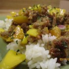 Sausage with Mango Salsa - Cilantro-lime rice is topped with a refreshing mango salsa and pan-fried turkey sausage for a zesty and colorful meal.
