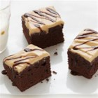 Peanut Butter Brownie Squares - Create a decadent peanut butter frosting, then drizzle our Duncan Hines Chocolate Decadence Brownies with a warm milk chocolate sauce. These Peanut Butter Brownie Squares are a winning combination.