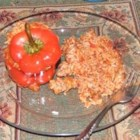 Sausage and Rice Stuffed Peppers - Stuffed green peppers with rice and sausage in cheesy tomato sauce. Tomato soup is used instead of tomato sauce.  Very, very good.