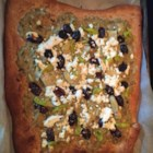 Mediterranean Whole Wheat Pizza - A quick, flavorful pizza done Mediterranean-style has a nutty whole wheat crust topped with feta cheese, artichoke hearts, olives, and pepperoncini peppers.
