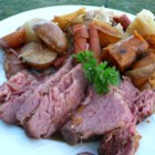 Stout Slow Cooker Corned Beef and Veggies - This slow cooker corned beef brisket is coated in brown sugar and cooked with Irish stout beer, red and sweet potatoes, and cabbage for a warm winter meal.