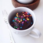 Fudgy Nutella(R) Mug Cake - This single-serving hazelnut cocoa cake can be made in less than 10 minutes with a little Nutella(R), cocoa powder, and coconut flour.