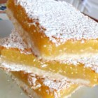 Best Lemon Squares - Lemony custard is baked on top of a simple crust in this recipe for the best lemon squares that has been passed down through many generations.