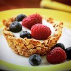 Breakfast Granola Cups - Breakfast granola cups, filled with yogurt and topped with your favorite fresh fruit, will be the star your next brunch gathering!