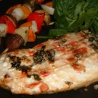 Glasser's Greek Marlin - Marlin steaks with a tomato and basil topping, cooked in a garlic butter sauce. This fish is terrific served with Greek olives and feta cheese.