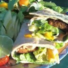 Fish Tacos with Honey-Cumin Cilantro Slaw and Chipotle Mayo - What's not to like about flavorful tacos stuffed with breaded, fried tilapia topped with chipotle mayo, Napa cabbage tossed in a honey-cumin sauce?