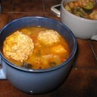 Albondigas Soup I - Rice and bite-sized meatballs made with pork and beef float in beef broth seasoned with green chili salsa, canned tomatoes, onion, garlic powder in this hearty Mexican soup for a crowd.