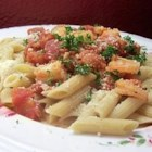 Penne with Shrimp - Tomatoes and onions are sauteed with garlic and wine, tossed with shrimp, and served with pasta in this quick and easy entree.