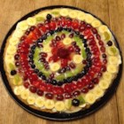 Fruit Pizza Even Better - Smooth cream cheese and fresh fruit sit atop a buttery cookie crust in this colorful dessert. The pineapple juice glaze makes a bright and sweet topping.