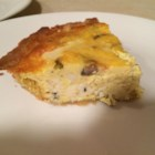 Crab and Mushroom Quiche - A gourmet quiche's flaky homemade crust encloses rich crabmeat and mushrooms. There's a golden layer of Italian cheese on top.