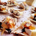 Petit Toasts with Brie, Fig, and Thyme - Impress your guests with toasts topped with Brie cheese, fig preserves, and a sprinkle of thyme at your next dinner party.