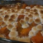Candied Sweet Potatoes - Sweet potatoes are parboiled and then baked with a sweet sauce of margarine, brown sugar, marshmallows, cinnamon and nutmeg.