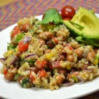 Amazing Mexican Quinoa Salad - Quinoa, corn, beans, and cilantro are tossed in a spicy chile dressing creating a Mexican-inspired salad perfect for lunch or dinner.