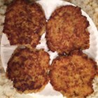 Quinoa Burgers - Use quinoa to make these meatless burgers with egg, onion, Parmesan cheese, and garlic.