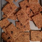Vegan Coconut-Oat Bars - Coconut, oats, and mashed banana make a great base for bars to be filled with your favorite dried fruits and chopped nuts in this simple recipe.