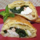 Shrimp Wellington - Shrimp stuffed with crabmeat and spinach, wrapped in puff pastry and baked in the oven. A wonderful appetizer or great served with a well-cut steak.