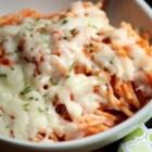 Creamy Baked Spaghetti - Spaghetti, prepared pasta sauce, mozzarella and cream cheese make a quick and cheesy comfort-food dinner.